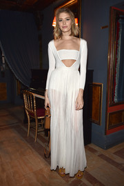 Elena Perminova rocked a combination of trends in a sheer white cutout dress during the label's aftershow dinner.