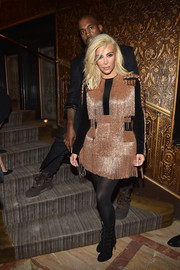 Kim Kardashian stood out in a fringed copper and black mini dress by Balmain during the label's aftershow dinner.