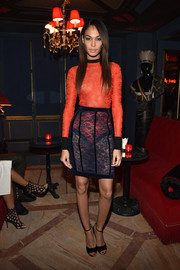 Joan Smalls showed off her svelte figure in a red Balmain lace bodysuit during the label's aftershow dinner.