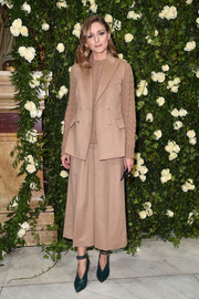 Olivia Palermo splashed on some color with a pair of green ankle-strap pumps by Jimmy Choo.