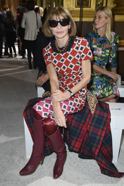 Anna Wintour looked vibrant in a diamond-print sheath dress at the Balmain fashion show.