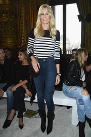 Claudia Schiffer was nautical-chic in a striped sweater by Balmain during the brand's fashion show.