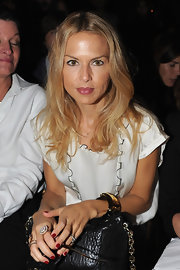 Rachel Zoe sported a perfect manicure at the Balmain ready-to-wear Spring/Summer 2012 fashion show. She chose a cool red for maximum impact and style. To get her look, try a color like OPI Nail Color in Mr. Right Now.