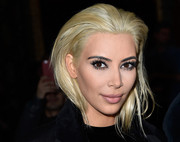 First, she chopped off her signature long locks. Now, Kim Kardashian's gone platinum blonde, debuting the new eye-catching 'do at the Balmain fashion show.