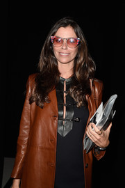 Christina Pitanguy accessorized with a super-cute pair of cateye sunnies at the Balmain fashion show.