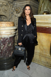 Eva Longoria layered a black Balmain blazer over a matching cami for the brand's Spring 2020 show.