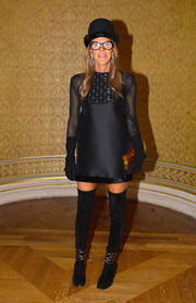 Anna dello Russo teamed her dress with embellished black thigh-high boots by Balenciaga.