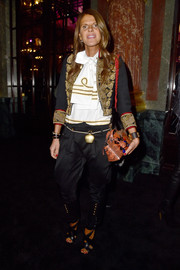 Black crisscross-strap sandals added a touch of femininity to Anna dello Russo's mannish look.