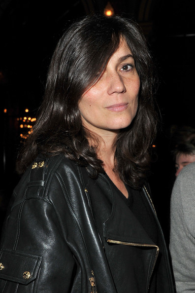 Emmanuelle Alt traded in her usual straight hair for some soft curls for added volume as she attended the Balmain show at Paris Fashion Week.