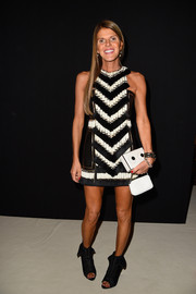 Tamer than usual but still funky, Anna dello Russo donned a mod black-and-white fringed mini for the Balmain fashion show.