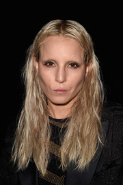 Noomi Rapace attended the Balmain fashion show wearing a messy center-parted 'do.