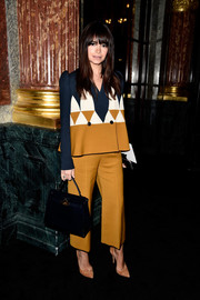 Miroslava Duma was business-chic in a tricolor geometric-patterned pantsuit at the Balmain fashion show.