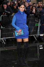 Miroslava Duma loaded up on the bold hues, accessorizing her bright blue outfit with a multicolored suede clutch.