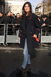 Emmanuelle Alt attended the Balmain fashion show dressed down in rugged brown boots, faded jeans, and a coat.