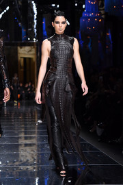 Kendall Jenner totally slayed in this crocodile dress while walking the Balmain runway.