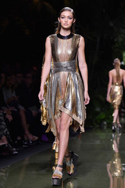 Gigi Hadid shone in a gold and silver chainmail cocktail dress while walking the Balmain show.