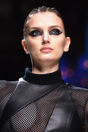 Lily Donaldson worked a sleek ponytail with a braided top at the Balmain runway show.
