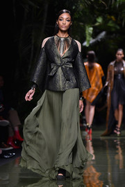 A flowing green skirt finished off Jourdan Dunn's outfit.
