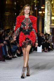 Natalia Vodianova was all abloom in this heavily appliqued mini dress at the Balmain runway show.