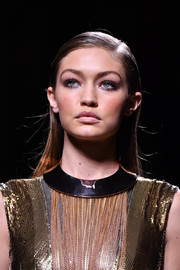Gigi Hadid sported a sleek side-parted hairstyle on the Balmain runway.
