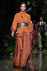 Alessandra Ambrosio was tough-glam in an ochre suede jacket layered over a matching maxi dress while walking the Balmain runway.