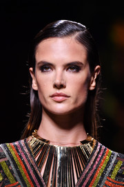 Alessandra Ambrosio rocked wet-look hair on the Balmain runway.