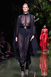 Constance Jablonski looked seductive in a sheer draped maxi dress while walking the Balmain runway.