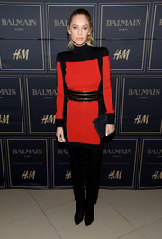 Dylan Penn cut a strong silhouette in a bold-shouldered red and black sweater dress by Balmain x H&M during the collection's pre-launch in Los Angeles.