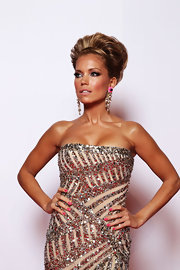 Sylvie van der Vaart glammed up her look with a pair of gold chandelier earrings with girly pink details.