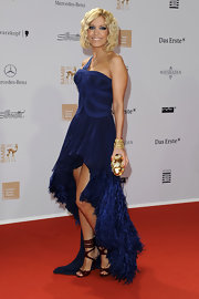 Slyvie van der Vaart topped off her navy blue evening gown with burgundy strappy sandals.