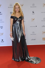 Katja Burkard accessorized her metallic pewter gown with a petite silver satin clutch.