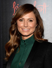 Stacy Keibler styled her hair with a side part and billowy waves for the Banana Republic L'Wren Scott collection launch.
