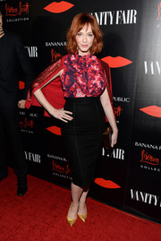 Christina Hendricks went to the Banana Republic L'Wren Scott collection launch wearing a floral ruffle blouse from the collaboration.
