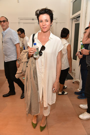 Garance Dore attended the Band of Outsiders Soho store opening wearing a casual white shirtdress teamed with pants.