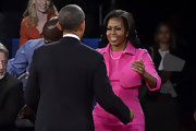 Michelle Obama wore a bright pink dress and jacket set for the second presidential debate in New York.