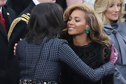 Beyonce accessorized her all-black inauguration outfit with emerald earrings.