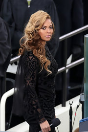 Beyonce stunned in a deep parted side sweep that revealed her elegant caramel curls.