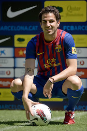Cesc Fabregas proudly poses in his new Barcelona kit.