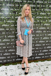 Laura Whitmore paired her dress with black espadrille wedges.