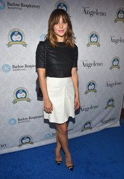Katharine McPhee was minimalist-chic in her white mini skirt and black crop-top combo.