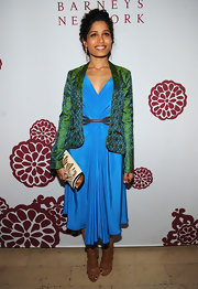 A green and blue blazer added an unexpected pop of color to Freida's already vibrant evening look.