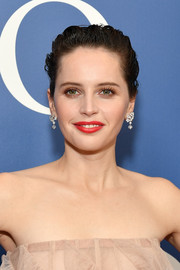 Felicity Jones brightened up her beauty look with a swipe of red lipstick for the New York screening of 'On the Basis of Sex.'