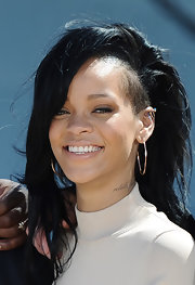 Rihanna attended a photocall for 'Battleship' wearing a pair of #4 squiggle hoop earrings.