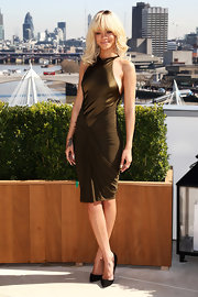 Rihanna shined at the 'Battleship' photocall in this olive silk dress.