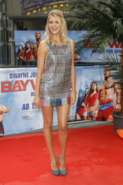 Kelly Rohrbach completed her sassy look with teal suede pumps by Casadei.