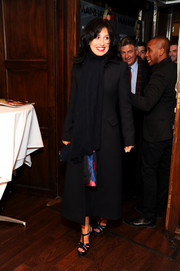 Hilaria Baldwin bundled up in style with a long black wool coat during her Beach magazine cover celebration.