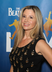 Mira Sorvino wore her long straight tresses loose when she attended the 'Beatles LOVE by Cirque du Soleil' 10th anniversary.