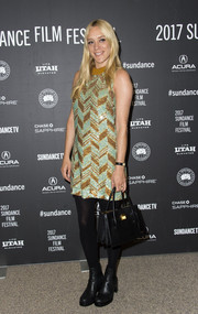 Chloe Sevigny topped off her ensemble with a black leather tote.