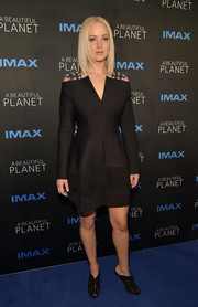 Jennifer Lawrence complemented her dress with black peep-toe mules by Olgana Paris.