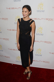 Jamie Chung went the ultra-modern route in a Three Floor LBD, featuring cutouts on the shoulders and sheer panels on the bodice, during the 'Beauty Book for Brain Cancer' edition 2 launch party.